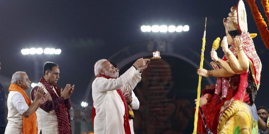 Prime Minister Narendra Modi performs 'aarti' in front of an idol of goddess Durga during the ongoing Navratri festival in Ahmedabad. (Photo | PTI)