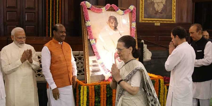 Prime minister Narendra Modi, Congress interim president Sonia Gandhi, Rahul Gandhi, Lok Sabha Speaker Om Birla paying tribute to  Mahatma Gandhi on 150th birth Anniversary at Parliament house in New Delhi on Wednesday. | (Photo | Shekhar Yadav / EPS)