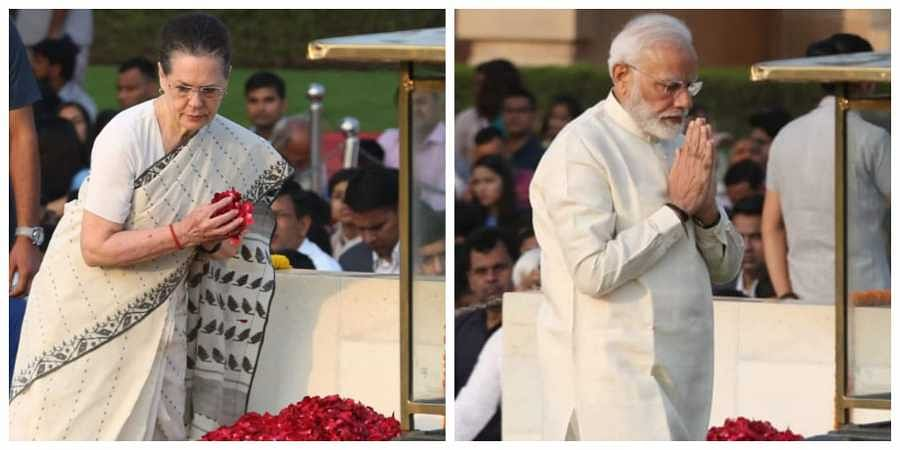 Congress chief Sonia Gandhi and PM Narendra Modi pay tribute to  Mahatma Gandhi on 150th birth Anniversary at Rajghat in New Delhi on Wednesday. | (Photo | Shekhar Yadav/EPS)