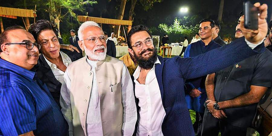 PM Narendra Modi poses for a selfie with Bollywood actors Shah Rukh Khan Aamir Khan and others at an event to mark Mahatma Gandhi's 150th birth anniversary year in New Delhi.