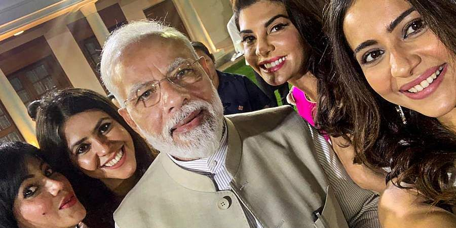 PM Narendra Modi poses for a selfie with Bollywood actor Jacqueline Fernandez, director Ekta Kapoor and others at an event to mark Mahatma Gandhi's 150th birth anniversary year in New Delhi.