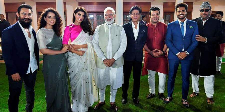 PM Narendra Modi in a group photo with Bollywood actors Aamir Khan, Kangana Ranaut, Jacqueline Fernandez, Shah Rukh Khan, Jackie Shroff and others at an event to mark Mahatma Gandhi's 150th birth anniversary year in New Delhi.