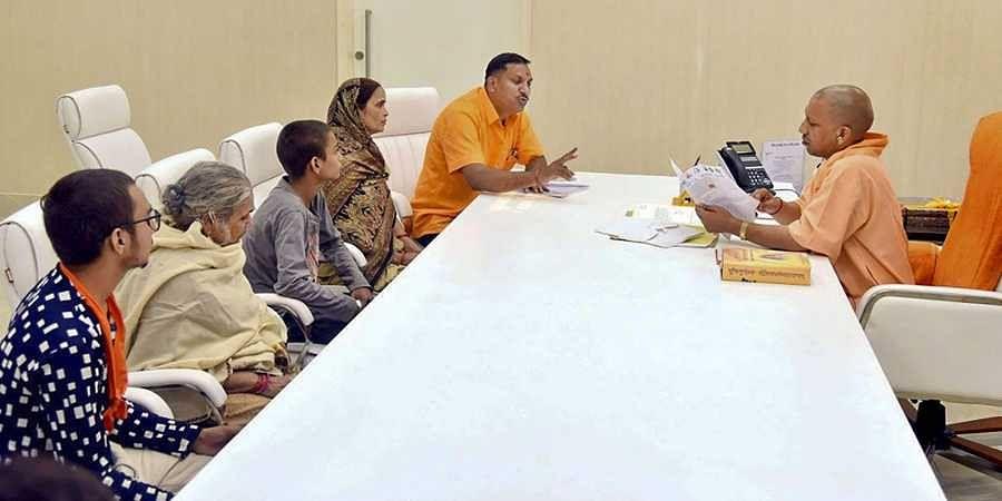 Family members of the slain Hindu Samaj Party chief Kamlesh Tiwari meet Uttar Pradesh Chief Minister Yogi Adityanath at his residence in Lucknow.