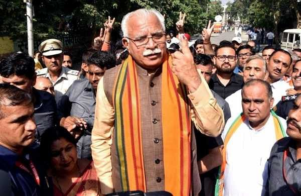 Haryana polls: CM Khattar travels by train to Karnal, then rides bicycle to cast his vote