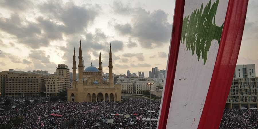 Anti-government protesters shout slogans in Beirut, Lebanon, Sunday, Oct. 20, 2019.