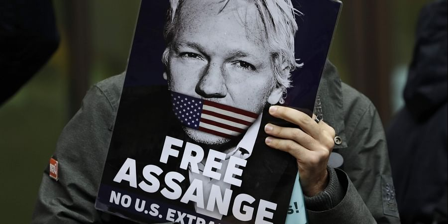 Supporters of Wikileaks founder Julian Assange demonstrate outside Westminster Magistrates' Court in London where Assange is expected to appear as he fights extradition to the United States on charges of conspiring to hack into a Pentagon computer, in London, Monday Oct. 21, 2019.