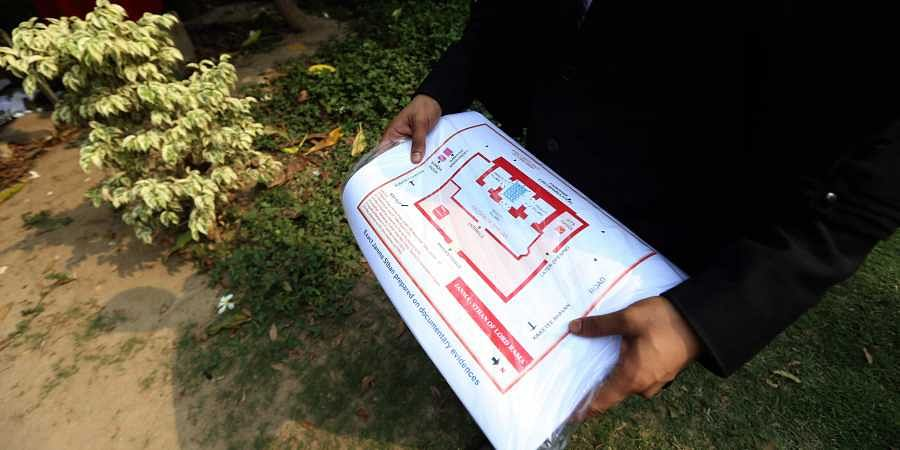 A lawyer holds a map of the alleged original site of Ram Janmabhoomi that was torn during the hearing of the Ayodhya land dispute case in the Supreme Court. (Photo | Arun Kumar, EPS)