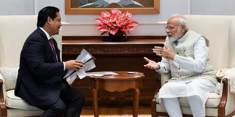 Meghalaya CMConrad Sangma interacting with PM Narendra Modi.