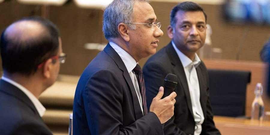 CEO Salil Parekh, center, and CFO Nilanjan Roy, right. (Photo | Karen Dias/Bloomberg)