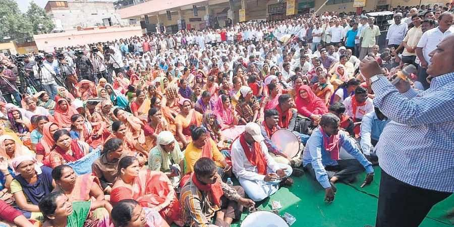 As the strike enters the 19th day, RTC workers stage a protest near Dilsukhnagar bus depot in Hyderabad on Wednesday