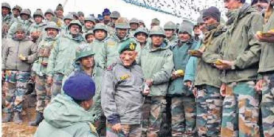 Army chief General Bipin Rawat speaks with a jawan