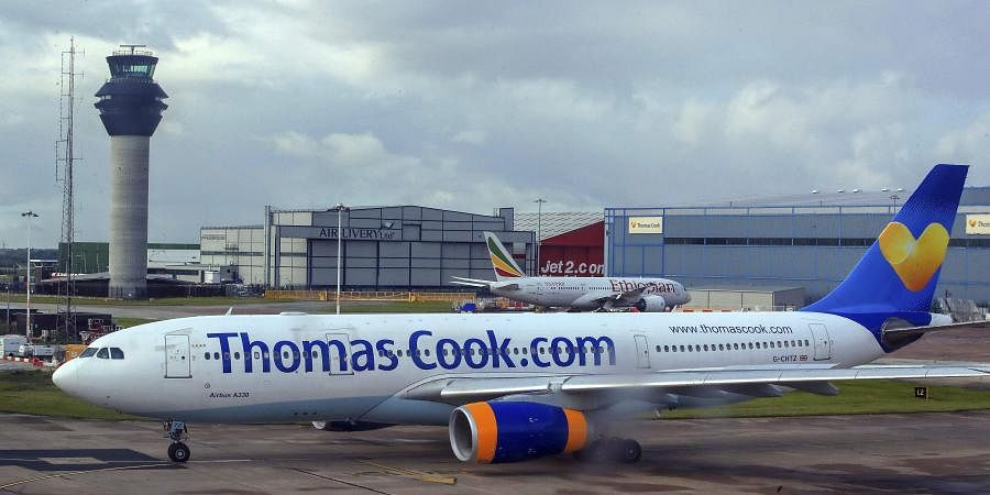 A Thomas Cook plane taxis on the runway at terminal one of Manchester Airport, England. (Photo | AP)