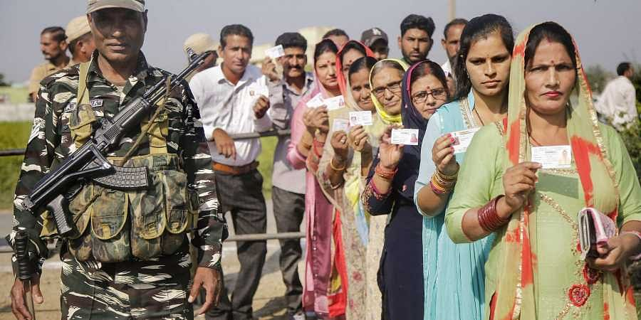 Panches and Sarpanches stand in a queue to cast their votes for Block Development Councils BDCs elections at Suchetgarh near international border in Jammu and Kashmir Thursday