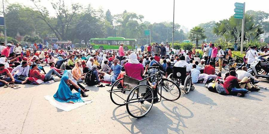 Differently abled protesters stage a sit-in on a road near Mandi House in New Delhi.