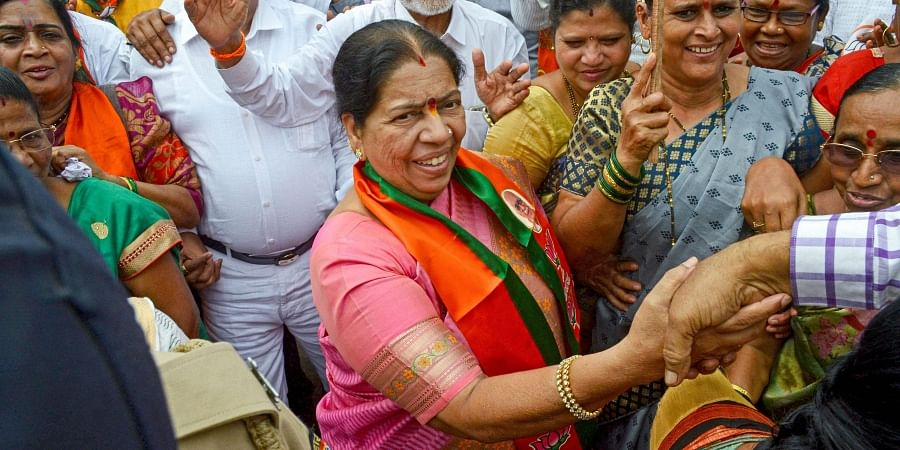 Navi Mumbai BJP candidate Manda Mhatre celebrates with supporters after her win in Maharashtra State Assembly elections at Agri Koli Bhavan Nerul in Navi Mumbai.
