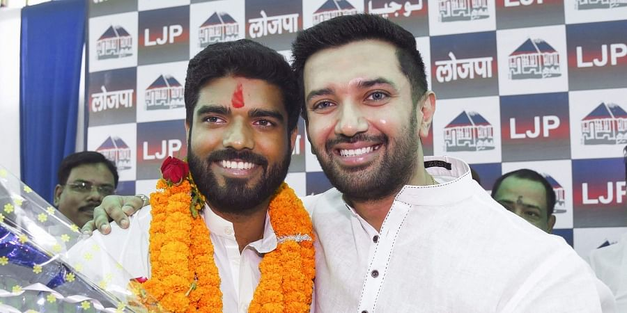 LJP parliamentary board chairman Chirag Paswan poses with the party's newly elected MP from Samastipur Prince Raj during a press conference in Patna Friday