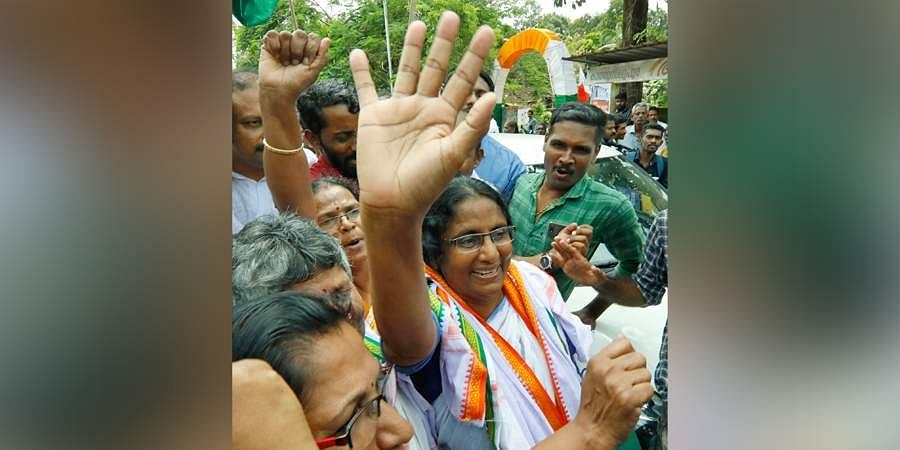 Shanimol waving hands at workers who gathered near the UDF election committee office at Pattukulangara near Thuravoor after the announcement of her victory