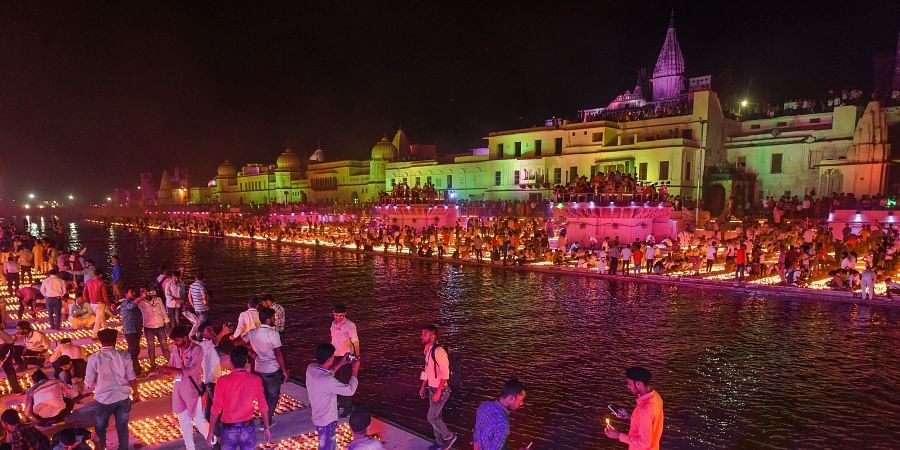 Devotees light earthen lamps on the bank of Saryu River during Deepotsav celebrations in Ayodhya.