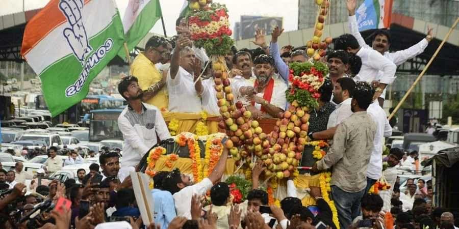 Congress leader D K Shivakumar arrives in Bengaluru to a rousing reception.