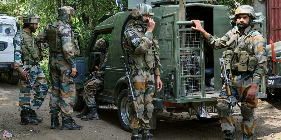 Army soldiers near the house where Militants were hiding during an encounter in Shopian.