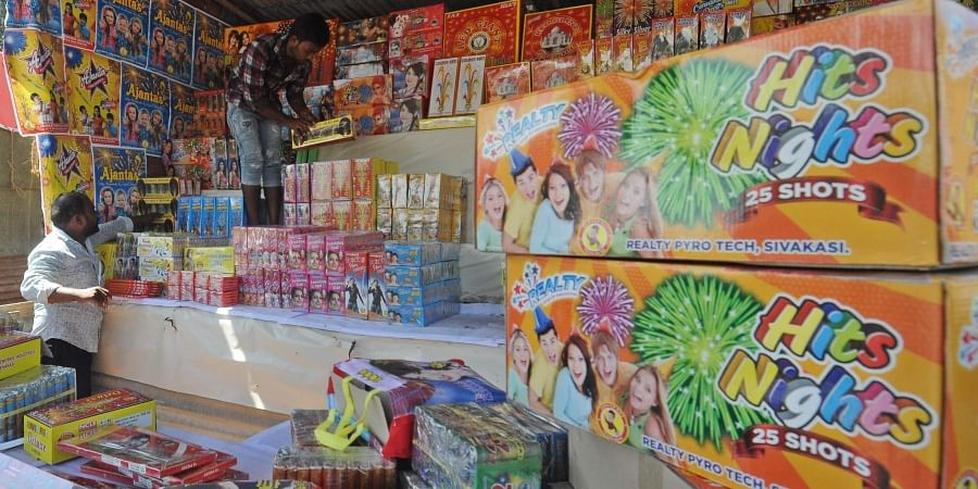 Vendors arranging crackers for sale at PWD ground in Vijayawada