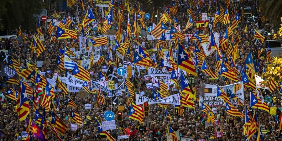 Catalan pro-independence protesters march during a demonstration in Barcelona, Spain.
