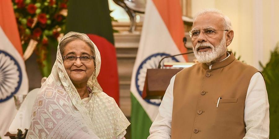 Prime Minister Narendra Modi with his Bangladeshi counterpart Sheikh Hasina. (Photo | PTI)