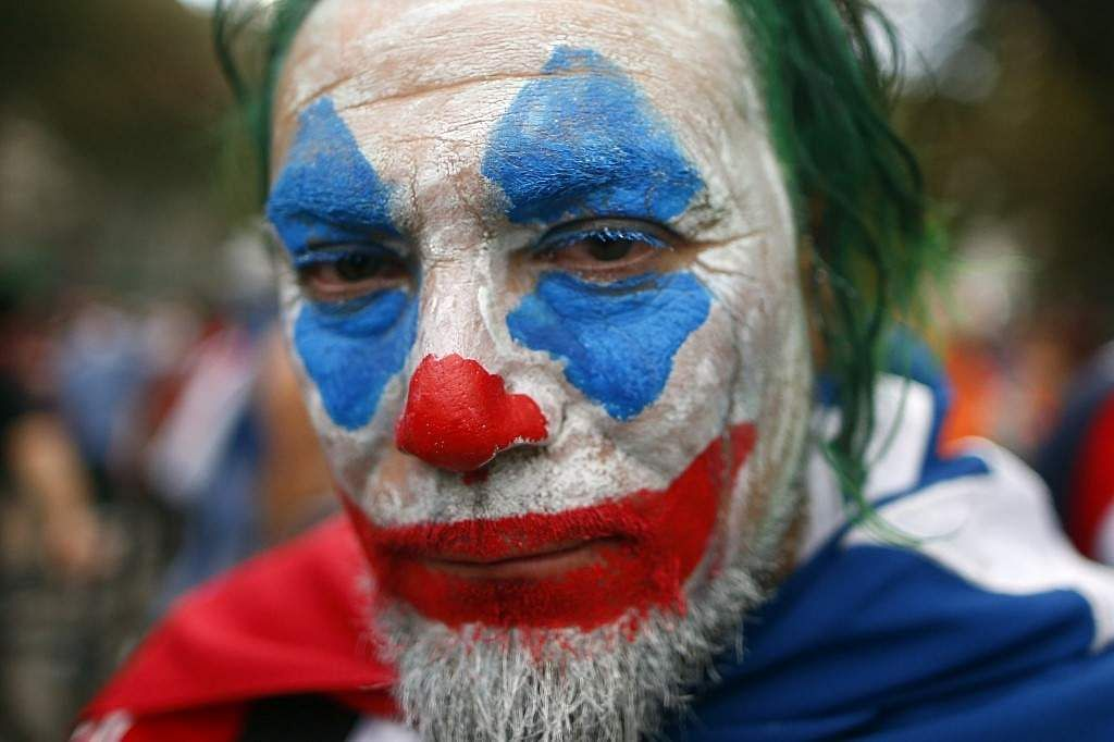 In a demonstration where over a million took to the streets of Santiago on October 25, 2019, a man is seen with his face painted to resemble the infamous 'Joker'. According to Al Jazeera, the week-long protest which started off with students raising their voice against metro fee hike later catapulted into countrywide protests on the country's inequality with privatization of heatlth care and education, rising cost of public transport services, while wages and pensions remain low.