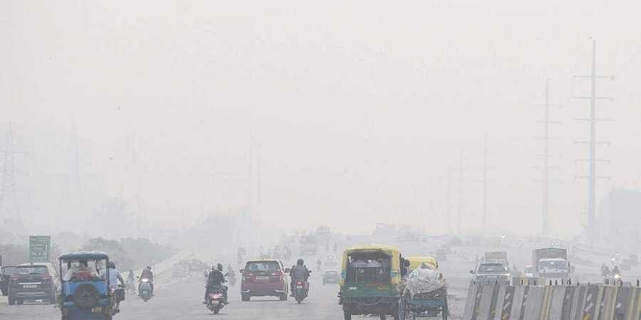 A thick blanket of smog shrouds the national capital. |