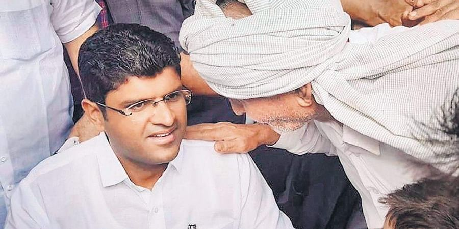 Jannayak Janata Party leader Dushyant Chautala interacts with locals in Sirsa district of Haryana.