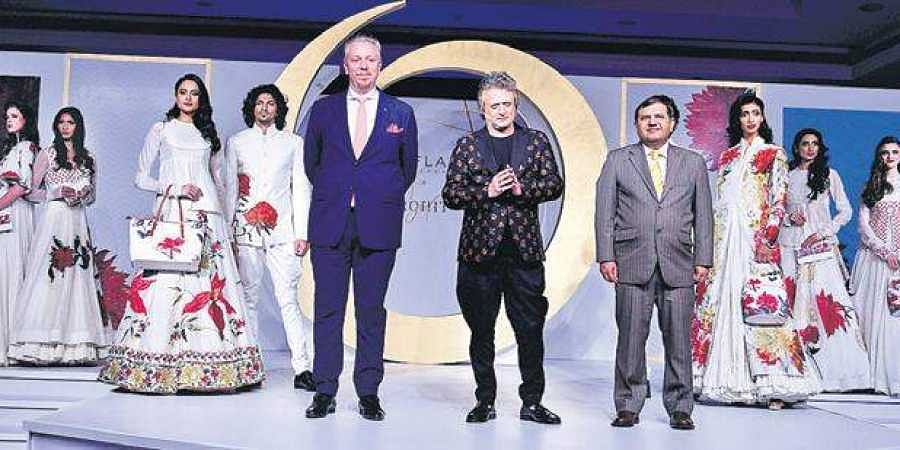 Frederic Widell, VP and Head of South Asia & MD, Oriflame India, Designer Rohit Bal and Naveen Anand, Senior Director, Marketing, Oriflame South Asia