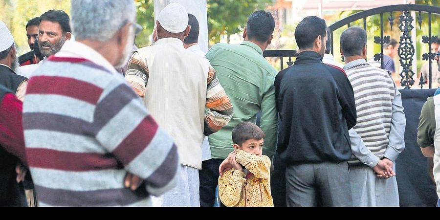 Relatives of political workers detained in the wake of abrogation of Article 370 wait to meet them outside a detention centre in Srinagar on Wednesday