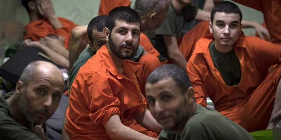 Men, suspected of being affiliated with the Islamic State (IS) group, gather in a prison cell in the northeastern Syrian city of Hasakeh. (Photo | AFP)