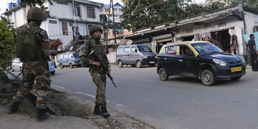 Soldiers stand guard on a street in Kohima on Thursday