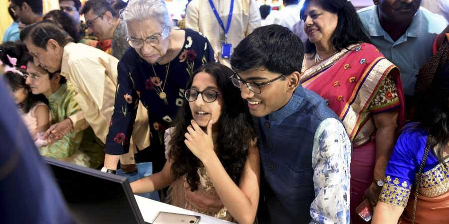 Stockbrokers trade as their family watch during a special 'muhurat' trading session for Diwali at BSE in Mumbai on 27 October 2019.