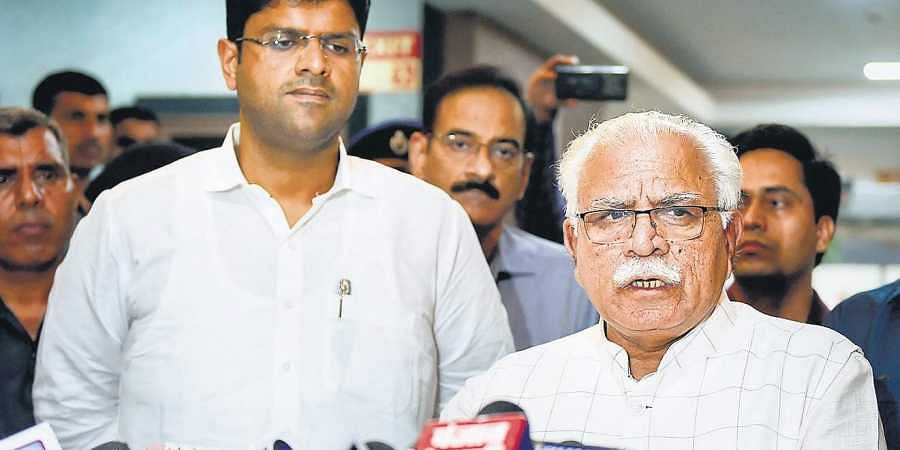 Haryana Chief Minister Manohar Lal Khattar addresses the media after a meeting, as Deputy Chief Minister Dushyant Chautala of the JJP looks on, at Haryana Bhawan in New Delhi on Tuesday