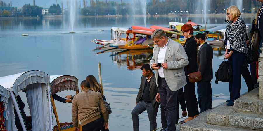 Members of European Union Parliamentary delegation board a shikara ride at Dal Lake in Srinagar
