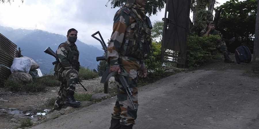 Soldiers keep guard on a street in Kohima, Nagaland