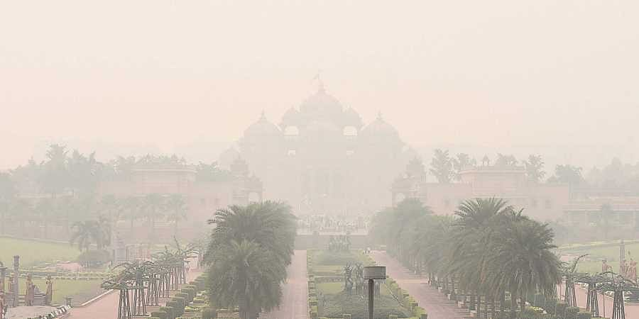 A thick blanket of smog shrouds the Akshardham temple in New Delhi on Wednesday. The air quality, which slipped to the 'severe' category in several parts of the city, has been rendered worse due to stubble burning in neighbouring Punjab, Haryana and Uttar Pradesh.
