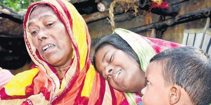 Family members of labourers, who were shot dead by terrorists in Jammu and Kashmir's Kulgam, mourn at their village in Murshidabad district of West Bengal, on Wednesday
