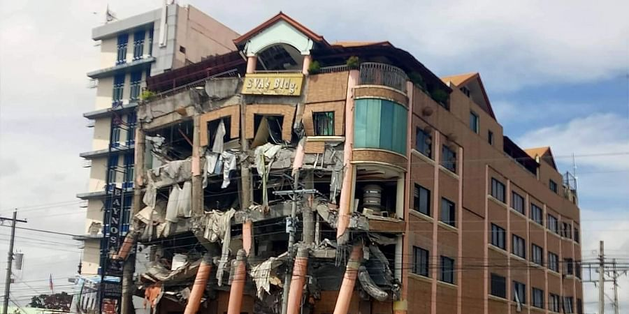 Eva's Hotel stands damaged after a strong earthquake in Kidapawan, north Cotabato province, Philippines.
