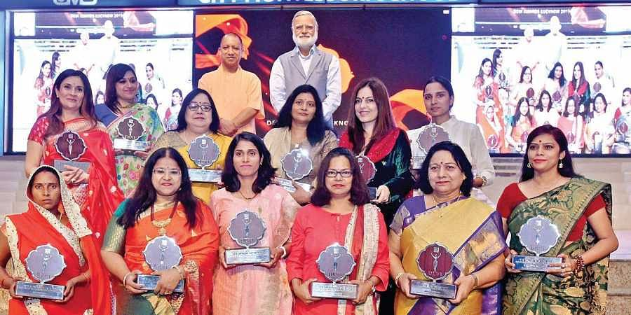 Uttar Pradesh Chief Minister Yogi Adityanath and The New Indian Express Group Editorial Director Prabhu Chawla with the Devi Award winners in Lucknow on Wednesday