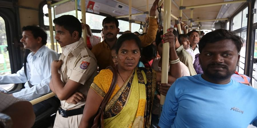 A marshal stands in a DTC bus in New Delhi.