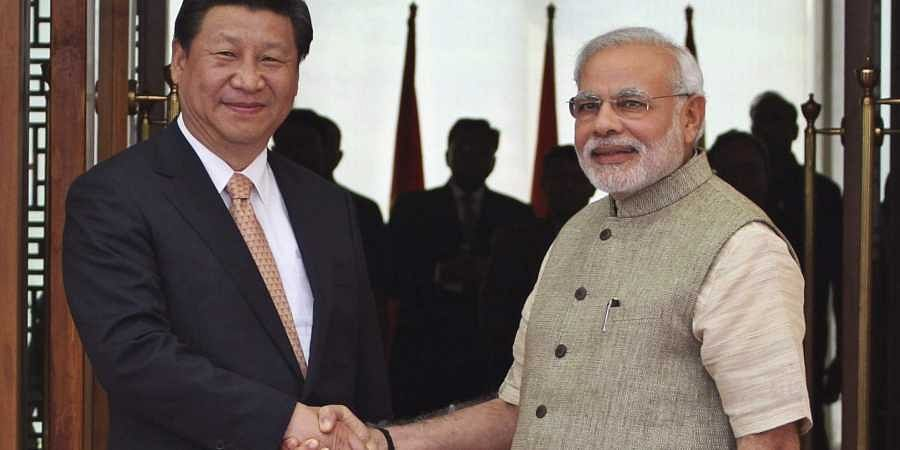 Prime Minister Narendra Modi, right, shakes hand with Chinese President Xi Jinping  (File | AP)