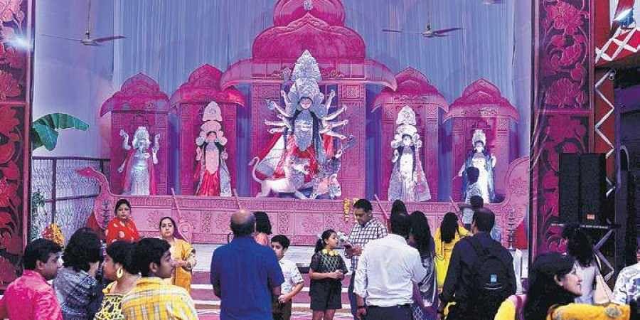 Devotees at a Durga Puja pandal at Minto Road in New Delhi.