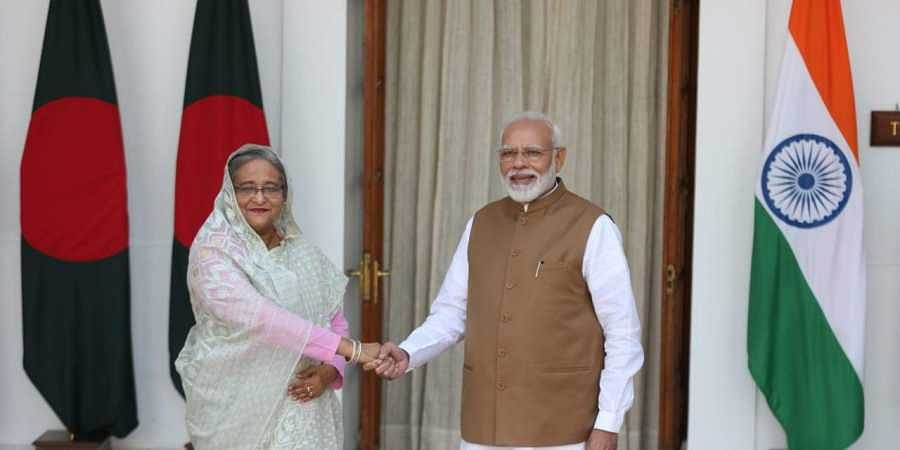 Prime minister Narendra Modi shakes hand with Bangladesh Prime Minister Sheikh Hasina before their meeting in New Delhi on Saturday. | (Shekhar Yadav | EPS)