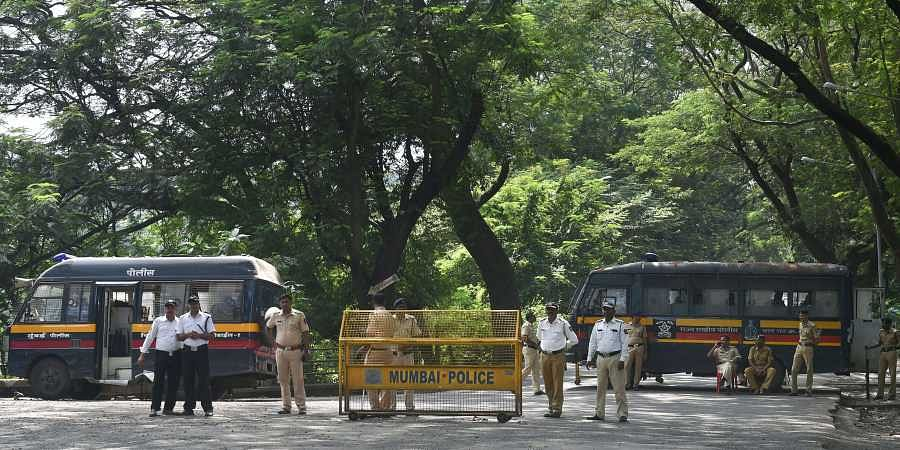 Police cordon off the area following a protest against the tree-cutting being carried out for the Metro car shed project at Aarey colony in Mumbai. (Photo | PTI)