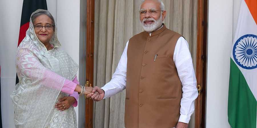 Prime Minister Narendra Modi shakes hands with his Bangladeshi counterpart Sheikh Hasina prior to a meeting at Hyderabad House in New Delhi