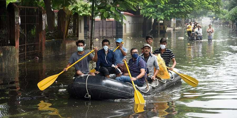 Volunteers of an NGO rescue residents from flood-affected area of Rajendra Nagar in Patna Saturday Oct. 5 2019. | (Photo | PTI)