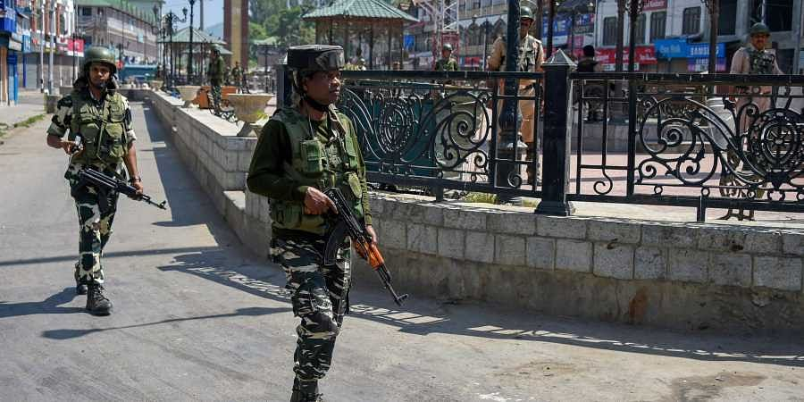 Security forces patrolling Kashmir Valley